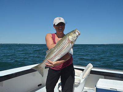 Woman holding bass fish